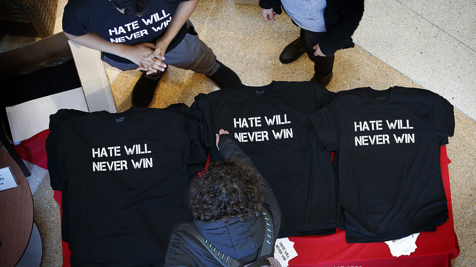 """Nebraska students hand out """"Hate Will Never Win"""" T-shirts in the Jackie Gaughan Multicultural Center before a campus rally in February 2018"""
