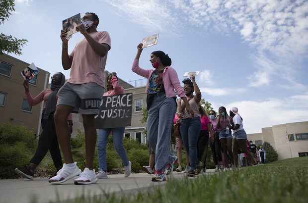 Members of the Black Student Union and the Lincoln community march during the Say Her Name Rally and Chalk Walk on July 3. The event was dedicated to Oluwatoyin Salau, a Black Lives Matter protester who was murdered in Florida, and other black women who have been killed.